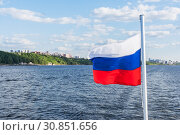 Russian flag on the background of the river, shore and sky. Стоковое фото, фотограф Дмитрий Тищенко / Фотобанк Лори