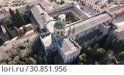 Купить «Aerial view of Monastery of Santa Maria de Santes Creus, Catalonia, Spain», видеоролик № 30851956, снято 14 февраля 2019 г. (c) Яков Филимонов / Фотобанк Лори