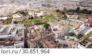 Купить «View from drone of residential areas of Spanish town of Jerez de la Frontera with Catholic Cathedral and former Moorish alcazar», видеоролик № 30851964, снято 19 апреля 2019 г. (c) Яков Филимонов / Фотобанк Лори