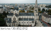Купить «Aerial view of picturesque Chateauroux cityscape with Catholic Church of Our Lady, central France», видеоролик № 30852012, снято 25 октября 2018 г. (c) Яков Филимонов / Фотобанк Лори