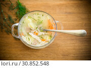 Chicken soup with noodles and carrot in white bowl. Стоковое фото, фотограф Peredniankina / Фотобанк Лори