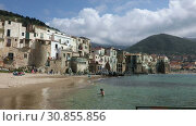 Купить «CEFALU, ITALY - APRIL 14, 2019: Panoramic view of the coastal line of the central part of the Sicilian town of Cefalu on a sunny spring day. Cefalu is one of the major tourist attractions in the Sicily region, Italy», видеоролик № 30855856, снято 14 апреля 2019 г. (c) Алексей Кузнецов / Фотобанк Лори