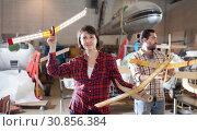 Купить «Couple having fun with plane models», фото № 30856384, снято 4 марта 2019 г. (c) Яков Филимонов / Фотобанк Лори