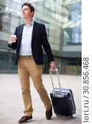Купить «Portrait of cheerful male standing with bag», фото № 30856468, снято 20 апреля 2017 г. (c) Яков Филимонов / Фотобанк Лори