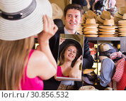 Купить «assistant holding mirror and showing woman his reflection in hats store», фото № 30856532, снято 2 мая 2017 г. (c) Яков Филимонов / Фотобанк Лори