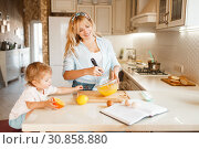 Купить «Mother and her daughter mixing fruits in a bowl», фото № 30858880, снято 6 марта 2019 г. (c) Tryapitsyn Sergiy / Фотобанк Лори