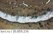 Купить «Aerial video from drone over frozen Kyzyl Chin river under ice. The tourist name of this territory is Mars. Altai, Siberia, Russia», видеоролик № 30859216, снято 27 мая 2019 г. (c) Serg Zastavkin / Фотобанк Лори