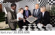 Купить «Business partners discussing in chess escape room», фото № 30859696, снято 29 января 2019 г. (c) Яков Филимонов / Фотобанк Лори