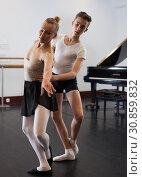 Купить «Ballet partners dancing gracefully together in the ballet studio», фото № 30859832, снято 26 апреля 2019 г. (c) Яков Филимонов / Фотобанк Лори