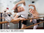 Teenager and women practicing at the ballet barre. Стоковое фото, фотограф Яков Филимонов / Фотобанк Лори