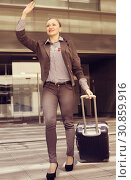 Купить «Adult woman worker going with baggage», фото № 30859916, снято 6 мая 2017 г. (c) Яков Филимонов / Фотобанк Лори