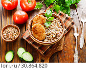 Купить «Buckwheat with burgers», фото № 30864820, снято 31 мая 2019 г. (c) Надежда Мишкова / Фотобанк Лори