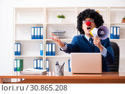 Купить «Young clown businessman working in the office», фото № 30865208, снято 14 декабря 2018 г. (c) Elnur / Фотобанк Лори