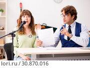 Купить «Young woman during music lesson with male teacher», фото № 30870016, снято 26 сентября 2018 г. (c) Elnur / Фотобанк Лори