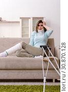 Купить «Young woman after car accident suffering at home», фото № 30870128, снято 26 февраля 2019 г. (c) Elnur / Фотобанк Лори