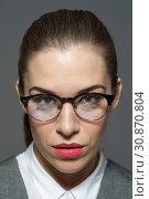 Купить «Young beautiful businesswoman or manager in glasses looks at the camera.», фото № 30870804, снято 21 декабря 2017 г. (c) Pavel Biryukov / Фотобанк Лори