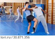 Купить «Two men practicing self defense techniques», фото № 30871356, снято 31 октября 2018 г. (c) Яков Филимонов / Фотобанк Лори