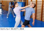 Купить «People practicing self defense techniques», фото № 30871364, снято 31 октября 2018 г. (c) Яков Филимонов / Фотобанк Лори
