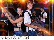 Купить «Team of laser tag guy and girl with laser pistols and friends», фото № 30871424, снято 27 августа 2018 г. (c) Яков Филимонов / Фотобанк Лори