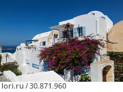 Купить «View of the city of Oia. Santorini Island in Greece», фото № 30871960, снято 9 июня 2017 г. (c) Наталья Волкова / Фотобанк Лори