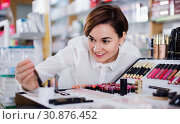 Купить «Female customer searching for reliable make-up products», фото № 30876452, снято 31 января 2017 г. (c) Яков Филимонов / Фотобанк Лори