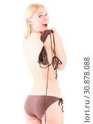 Junge frau zog ihr bikinioberteil aus und wirkt überrascht. Стоковое фото, фотограф Zoonar.com/Wladimir Wetzel / easy Fotostock / Фотобанк Лори