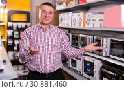 Купить «Middle-class man in appliances store», фото № 30881460, снято 1 марта 2018 г. (c) Яков Филимонов / Фотобанк Лори