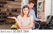Купить «Couple is choosing new motobike and woman is surprised choice her husband», фото № 30881584, снято 8 мая 2018 г. (c) Яков Филимонов / Фотобанк Лори