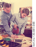 Woodworker working with pupil. Стоковое фото, фотограф Яков Филимонов / Фотобанк Лори