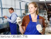Купить «Woman working in glass workshop», фото № 30881716, снято 10 сентября 2018 г. (c) Яков Филимонов / Фотобанк Лори