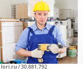 Купить «Construction worker holding electric perforator», фото № 30881792, снято 4 мая 2018 г. (c) Яков Филимонов / Фотобанк Лори