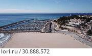 Купить «Picturesque aerial view of Mediterranean coastal town of Torredembarra with yachts moored in harbor, Tarragona, Spain», видеоролик № 30888572, снято 18 марта 2019 г. (c) Яков Филимонов / Фотобанк Лори