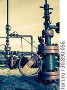 Купить «Group of wellhead. Oilfield with sand ground. Oil and gas. Toned.», фото № 30890056, снято 19 ноября 2019 г. (c) easy Fotostock / Фотобанк Лори