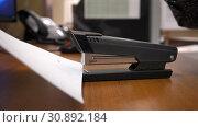 Купить «Fist presses stapler with paper clip», видеоролик № 30892184, снято 12 января 2019 г. (c) Aleksandr Sulimov / Фотобанк Лори