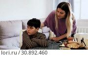 Купить «Upset mother and offended son arguing in domestic interior», видеоролик № 30892460, снято 26 февраля 2019 г. (c) Яков Филимонов / Фотобанк Лори