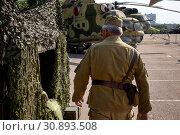 Купить «Реконструкция расположения военной части советской армии в Афганистане в рамках фестиваля Времена и эпохи в Москве», фото № 30893508, снято 7 июня 2019 г. (c) Николай Винокуров / Фотобанк Лори