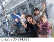 Купить «Children playing in bunker quest room», фото № 30894888, снято 21 октября 2017 г. (c) Яков Филимонов / Фотобанк Лори