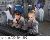Купить «Kids unravel the secret in the quest room», фото № 30894892, снято 21 октября 2017 г. (c) Яков Филимонов / Фотобанк Лори
