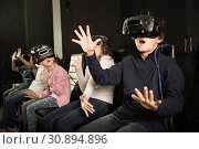 Купить «Enthusiastic children in virtual reality glasses in quest room», фото № 30894896, снято 21 октября 2017 г. (c) Яков Филимонов / Фотобанк Лори