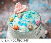 Купить «Tasty cocktail and sweets on a wooden table», фото № 30895548, снято 12 апреля 2019 г. (c) Алексей Кокорин / Фотобанк Лори