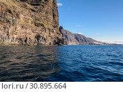 Купить «View from the boat to Los Gigantes rock at Tenerife island - Canary Spain», фото № 30895664, снято 27 декабря 2017 г. (c) Konstantin Shabalin / Фотобанк Лори
