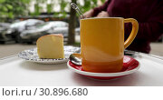 Купить «Close-up cup of tea in open air cafe», видеоролик № 30896680, снято 11 июня 2019 г. (c) Ekaterina Demidova / Фотобанк Лори
