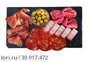 Купить «Top view of meat platter on slate board», фото № 30917472, снято 26 августа 2019 г. (c) Яков Филимонов / Фотобанк Лори