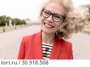 Zestful senior woman (67 years old) in park, in Nymphenburg, Munich, Germany. Стоковое фото, фотограф Benjamin Egerland / age Fotostock / Фотобанк Лори