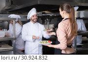 Купить «Chef with team preparing food», фото № 30924832, снято 8 января 2018 г. (c) Яков Филимонов / Фотобанк Лори