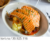Купить «Tasty steak of grilled salmon in sauce with pepper and lemon on plate», фото № 30925116, снято 28 ноября 2018 г. (c) Яков Филимонов / Фотобанк Лори