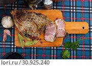 Купить «Appetizing pork ham with spices on a cutting board», фото № 30925240, снято 17 июля 2019 г. (c) Яков Филимонов / Фотобанк Лори
