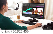 Купить «woman with video editor program on computer», видеоролик № 30925456, снято 23 августа 2019 г. (c) Syda Productions / Фотобанк Лори