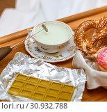Купить «Focus on cappuccinator and antique porcelain cup. green chocolate with matcha tea, and pretzels with iced donuts», фото № 30932788, снято 9 февраля 2019 г. (c) katalinks / Фотобанк Лори