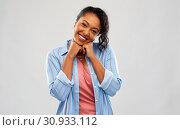 Купить «cute african american woman over grey background», фото № 30933112, снято 2 марта 2019 г. (c) Syda Productions / Фотобанк Лори
